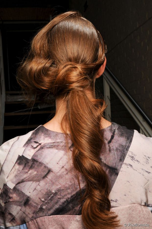 Ponytail With A Bun And Waves